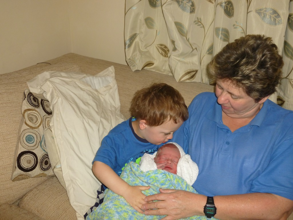 Kate's surprise home birth - Aaron meeting Daniel with grandma